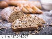 Купить «loaf of bread on a wooden board», фото № 27544567, снято 18 октября 2016 г. (c) Татьяна Яцевич / Фотобанк Лори