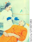 Doctor starting to do beauty procedures to female atient. Стоковое фото, фотограф Яков Филимонов / Фотобанк Лори