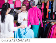 Купить «Young loving couple deciding on new sportswear», фото № 27547243, снято 22 ноября 2016 г. (c) Яков Филимонов / Фотобанк Лори