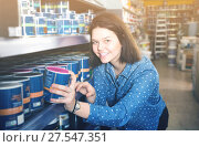 Купить «female customer examining various wall paints in paint store», фото № 27547351, снято 9 марта 2017 г. (c) Яков Филимонов / Фотобанк Лори