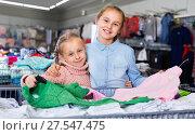 Купить «Two small happy sisters satisfied with purchases in children clothing shop», фото № 27547475, снято 27 декабря 2017 г. (c) Яков Филимонов / Фотобанк Лори