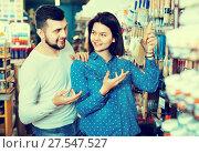 Купить «Loving couple deciding on brush for decorating house», фото № 27547527, снято 9 марта 2017 г. (c) Яков Филимонов / Фотобанк Лори