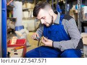 Купить «Worker repairs a plug with a screwdriver», фото № 27547571, снято 15 марта 2017 г. (c) Яков Филимонов / Фотобанк Лори