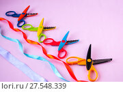 Купить «Multicolored ribbons and scissors on a pink background», фото № 27548339, снято 27 января 2018 г. (c) Катерина Белякина / Фотобанк Лори