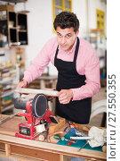 Купить «Craftsman working on woodworking machine», фото № 27550355, снято 8 апреля 2017 г. (c) Яков Филимонов / Фотобанк Лори