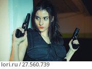 Купить «Model brunette girl with gun in a garage in attitude shoot, dressed in bulletproof vest», фото № 27560739, снято 26 мая 2020 г. (c) easy Fotostock / Фотобанк Лори