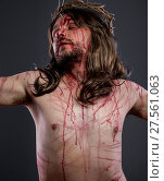 Купить «Jesus christ, jesus of nazareth with the crown of thorns and blood for his body as penance before the crucifixion», фото № 27561063, снято 2 апреля 2020 г. (c) easy Fotostock / Фотобанк Лори