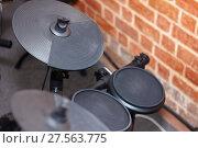 Купить «Close up image of a modern electronic drum sets as musical background», фото № 27563775, снято 26 ноября 2017 г. (c) Нелли Сабитова / Фотобанк Лори