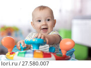 Купить «Portrait of baby playing in baby walker», фото № 27580007, снято 16 ноября 2018 г. (c) Оксана Кузьмина / Фотобанк Лори