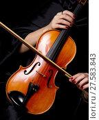 Купить «Violinist Holds Bow Across Saturated Musical Violin», фото № 27583843, снято 25 мая 2018 г. (c) PantherMedia / Фотобанк Лори