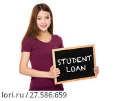 Купить «Young student hold with chalkboard showing phrase student loan», фото № 27586659, снято 23 июля 2018 г. (c) PantherMedia / Фотобанк Лори