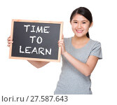 Купить «Young student hold with black board showing phrase time to learn», фото № 27587643, снято 23 июля 2018 г. (c) PantherMedia / Фотобанк Лори
