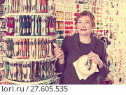 Купить «Woman buying embroidery accessories», фото № 27605535, снято 10 мая 2017 г. (c) Яков Филимонов / Фотобанк Лори
