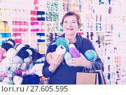 Купить «Woman holding shopping bags and accessories for knitting and embroidery», фото № 27605595, снято 10 мая 2017 г. (c) Яков Филимонов / Фотобанк Лори