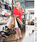 Купить «female buyer showing choice in shoes shop», фото № 27608159, снято 27 мая 2017 г. (c) Яков Филимонов / Фотобанк Лори