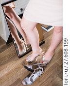 Купить «woman posing in new sandals in heels», фото № 27608199, снято 27 мая 2017 г. (c) Яков Филимонов / Фотобанк Лори