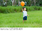 Купить «Asian kid catch with his orange ballon», фото № 27619431, снято 16 октября 2018 г. (c) PantherMedia / Фотобанк Лори