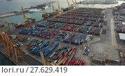 Купить «Shipping containers at Industrial port of Barcelona in daytime.», видеоролик № 27629419, снято 25 декабря 2017 г. (c) Яков Филимонов / Фотобанк Лори