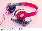 Купить «cassette tape and headphones», фото № 27631335, снято 20 января 2019 г. (c) PantherMedia / Фотобанк Лори