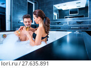 Купить «Beautiful young couple drinking Champagne in the Whirlpool», фото № 27635891, снято 24 апреля 2018 г. (c) PantherMedia / Фотобанк Лори