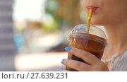 Купить «Woman drinking chocolate cocktail outdoor», видеоролик № 27639231, снято 10 декабря 2018 г. (c) Данил Руденко / Фотобанк Лори