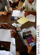 Купить «AMK microfinance and CARD disbursing funds for beneficiaries of a Unicef program.», фото № 27644075, снято 8 декабря 2019 г. (c) age Fotostock / Фотобанк Лори
