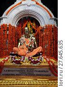 Купить «A. C. Bhaktivedanta Swami Prabhupada's mausoleum in Vrindavan.», фото № 27645635, снято 22 марта 2019 г. (c) age Fotostock / Фотобанк Лори