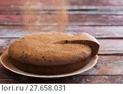 Купить «chocolate sponge cake on old wooden background», фото № 27658031, снято 22 января 2018 г. (c) Майя Крученкова / Фотобанк Лори