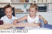 Купить «Boy with sister are playing in game at home.», видеоролик № 27660527, снято 11 августа 2017 г. (c) Яков Филимонов / Фотобанк Лори
