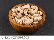 Купить «Pistachio nuts in bowl», фото № 27664635, снято 23 апреля 2019 г. (c) PantherMedia / Фотобанк Лори