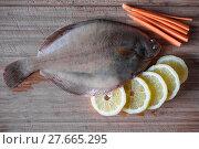 Купить «fresh flounder with lemon and carrot», фото № 27665295, снято 6 июля 2020 г. (c) PantherMedia / Фотобанк Лори