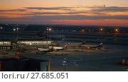 Купить «Terminal D of Sheremetyevo Airport, night view. Moscow, Russia», видеоролик № 27685051, снято 7 августа 2017 г. (c) Данил Руденко / Фотобанк Лори