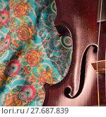 Купить «Antique violin closeup, square, against intricate pattern», фото № 27687839, снято 16 августа 2018 г. (c) PantherMedia / Фотобанк Лори