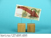 Купить «Chinese yuan decline illustrated over blue», фото № 27691691, снято 15 декабря 2018 г. (c) PantherMedia / Фотобанк Лори