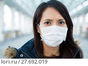 Купить «Woman wearing face mask at outdoor», фото № 27692019, снято 7 ноября 2019 г. (c) PantherMedia / Фотобанк Лори