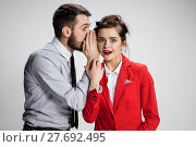 Купить «Young man telling gossips to his woman colleague at the office», фото № 27692495, снято 26 мая 2018 г. (c) PantherMedia / Фотобанк Лори