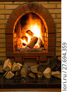 Купить «wood and fire in fireplace», фото № 27694359, снято 26 марта 2019 г. (c) PantherMedia / Фотобанк Лори