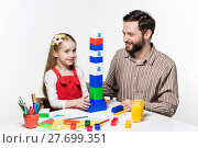 Купить «Father and daughter playing educational games together», фото № 27699351, снято 20 июня 2019 г. (c) PantherMedia / Фотобанк Лори