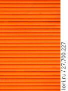 Купить «Orange horizontal roller shutter blinds», фото № 27700227, снято 21 мая 2019 г. (c) PantherMedia / Фотобанк Лори