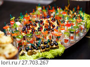 Купить «catering services background with snacks and food in restaurant», фото № 27703267, снято 23 мая 2019 г. (c) PantherMedia / Фотобанк Лори