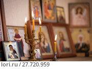 Купить «candle against the background of orthodox icons», фото № 27720959, снято 1 февраля 2018 г. (c) Типляшина Евгения / Фотобанк Лори