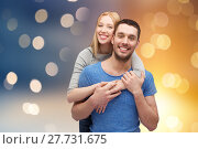 Купить «happy couple hugging over lights background», фото № 27731675, снято 9 февраля 2014 г. (c) Syda Productions / Фотобанк Лори