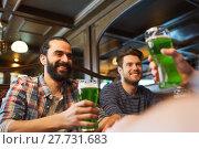 Купить «male friends drinking green beer at bar or pub», фото № 27731683, снято 22 апреля 2015 г. (c) Syda Productions / Фотобанк Лори