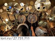 Купить «male musician playing drum kit at concert», фото № 27731711, снято 18 августа 2016 г. (c) Syda Productions / Фотобанк Лори