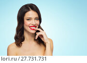 Купить «beautiful smiling young woman with red lipstick», фото № 27731731, снято 5 января 2018 г. (c) Syda Productions / Фотобанк Лори