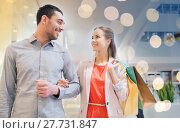 Купить «happy young couple with shopping bags in mall», фото № 27731847, снято 10 ноября 2014 г. (c) Syda Productions / Фотобанк Лори