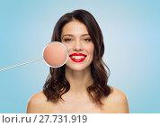 Купить «beautiful woman with magnified smooth facial skin», фото № 27731919, снято 5 января 2018 г. (c) Syda Productions / Фотобанк Лори