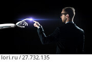 Купить «robot and human hand flash light over black», фото № 27732135, снято 6 сентября 2016 г. (c) Syda Productions / Фотобанк Лори