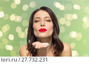 Купить «beautiful woman with red lipstick blowing air kiss», фото № 27732231, снято 5 января 2018 г. (c) Syda Productions / Фотобанк Лори