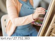 Купить «artist with brush painting at art studio», фото № 27732383, снято 1 июня 2017 г. (c) Syda Productions / Фотобанк Лори